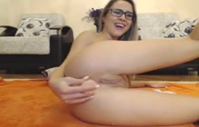 Adorable camgirl plays with a dildo